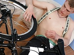 He sits naked on the bike, then lays back and grabs his cock with both hands gay foot fetish se