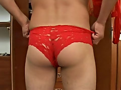 Then he's fishing in his wardrobe for the red spread adjust of undies and nylons and pulling up his lacy panties smoothing them on his round chee